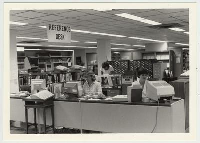 Librarians Judy Sackett (left) and Carla Cantagallo (right) at the Margaret I. King Library Reference Desk