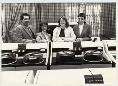 Mike Lach with three unidentified female librarians; Submitted for use the the 1983 / 1984 annual Report