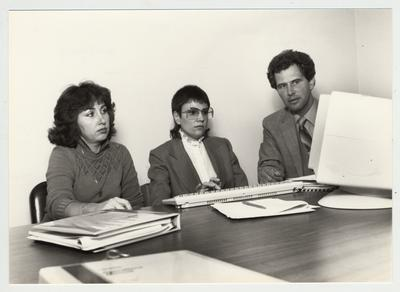 Gail Kennedy (left) and Mike Lach sit with an unidentified woman at a computer; Submitted for use the the 1983 / 1984 annual Report