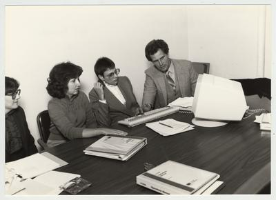 Gail Kennedy (second from left) and Mike Lach sit with two unidentified women; Submitted for use the the 1983 / 1984 annual Report