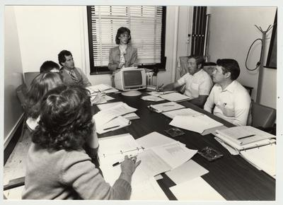 Gail Kennedy (left), Mike Lach (fourth from left) and Phillip Planck (second from right) and Ben Rice (right), of the Computer Center; Submitted for use the the 1983 / 1984 annual Report