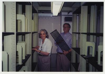 Jim Birchfield and Cheryl Jones replacing shelves in the core stacks after cleaning them