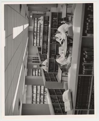 Men reading books in the Medical Library (located in the Medical Center)
