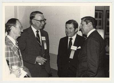 Leonard Press (far left), Director of KET; George Joplin III (second from left); Albert P. Smith, Jr. (second from right), commentator for KET Television Program Comment on Kentucky; and an unidentified man are conversing at the Hillbrook Collection dedication