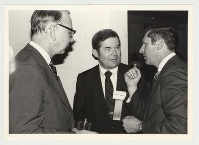 George Joplin III (far left); Albert P. Smith, Jr. (second from right), commentator for KET Television Program Comment on Kentucky; and an unidentified man are conversing at the Hillbrook Collection dedication