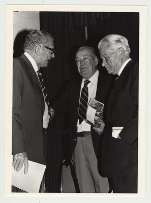 UK President Otis Singletary (left) and Bert Combs (right); The occasion was the presentation of the Wetherby papers to the university; Former Governor Lawrence Wetherby stands in the center; Photographer: Chuck Perry