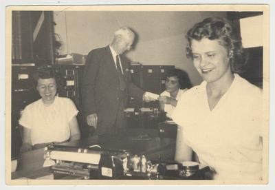 Office of Bureau of Source Material in Higher Education, later named University Archives and Records Program; From left: Betty Congleton; Ezra L. Gillis, University Archivist; Andy Diamondis; and Elaine Center