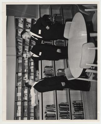 Men converse in the Medical Center Library at the Medical Center dedication