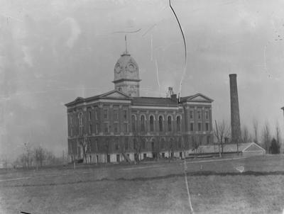 Administration Building, with rounded cupola; smoke stack in foreground, Gillis Building to the right