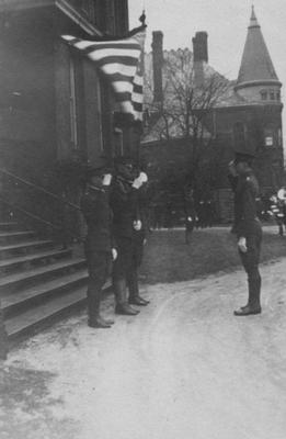 Cadets saluting in front of Administration Building; Gillis Building is to the right