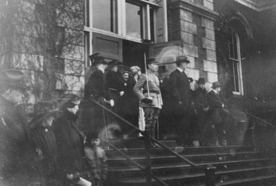 Group of people in front of the Administration Building; man on far left, top of stairs (with white beard) is James K. Patterson (UK President, 1878-1910), man standing next to cadet is Frank L. McVey (UK President, 1917-1940)
