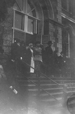 Group of people in front of the Administration Building; man on far left, top of stairs (with white beard) is James K. Patterson (UK President, 1878-1910)