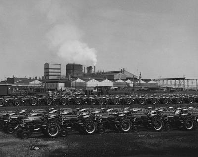 Rows of Farmall tractors lined up, possibly outside the International Harvester plant in Milwaukee; Agricultural Experiment Station Information Department photo