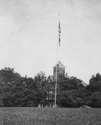 Flag pole in front of Barker Hall