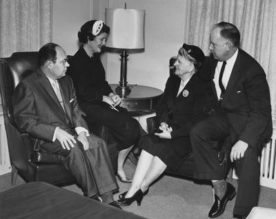 Mr. and Mrs. Lesshaft (left) and Mr. and Mrs. Doughty (right) in the boardroom at Carnahan House; Public Relations photo