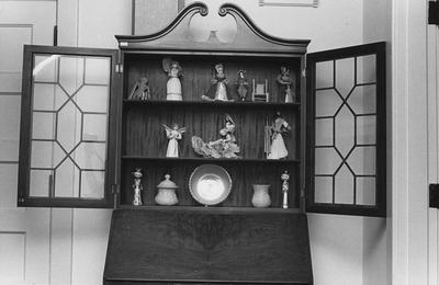 Curio cabinet with various knickknacks on display in the Carnahan House