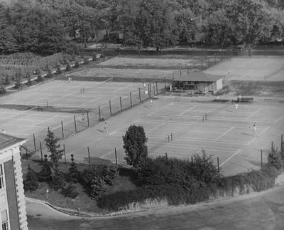 Unidentified people playing on the tennis courts which are located on the corner of Rose Street and Clifton. The current site of the Chemistry and Physics Building