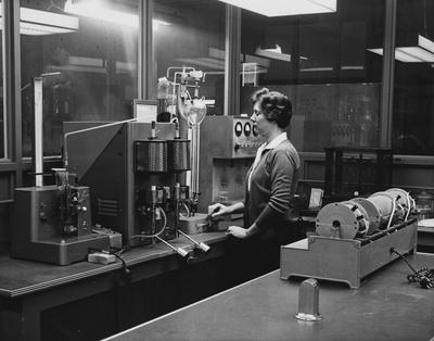 An unidentified woman is performing an experiment