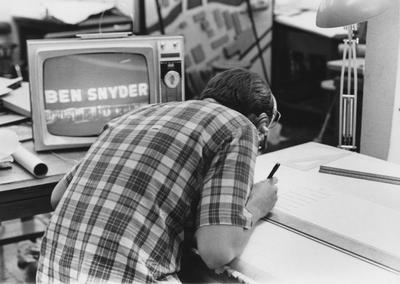 An unidentified student wearing headphones while working on a project in Pence Hall. This photograph appears second on page 193 in the 1969