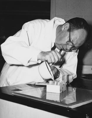 An unidentified man performing an experiment