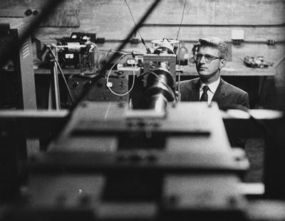 An unidentified man looking at a machine