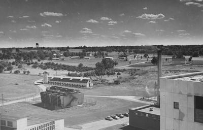 A view of a field before the erection of the Commonwealth Stadium, near the E. S. Good Building. This photo was taken from the V. A. Hospital while under construction. The photo was donated on September 12, 1979, by Earl Robert Young