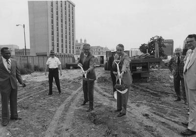 Governor Wendell Ford with University of Kentucky President Otis Singletary at the groundbreaking in Louisville for Jefferson Community College addition, the Learning Resources Center. At left is John Smith; at right is Stanley Wall