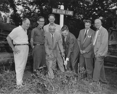 Mayor Harry B. Schnecler and President Frank Dickey, break ground for Northern Center building. Also present are Covington Commissioners Robert Northcut and Ray Vehrman, City Manager Oscar Hesch, Commissioner Bernard Eichholz and George Ankenbauer. Received June 13, 1959 from Cincinnati Enquirer. Photographer: Howard Pille