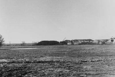 A sepia tone photo of the construction of buildings for Owensboro Community College. Owensboro Community College opened for classes in the fall of 1984. This photo was donated by Larry S. Miller, Dean of Student Affairs at Owensboro Community College. At the time of donation, the address read: Owensboro Community College, 920 Frederica Street, Owensboro, Kentucky 42301-3050 (address may have changed due to new constructions)