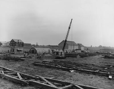 Preparation for fabricated houses. Photographer: W. E. Sutherland