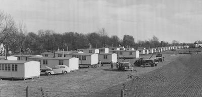 Set up of fabricated houses for ex-service men who attended University of Kentucky. Photographer: Bluegrass Studio