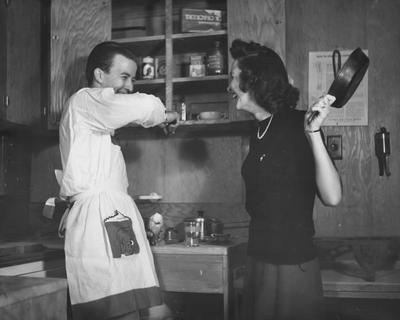 Couple, Mr. and Mrs. James Bostic, are in the kitchen of an old prefabricated Cooperstown house. (Mrs. Bostic's maiden name was Frances Murphy) The couple resided in 1964, in Louisville