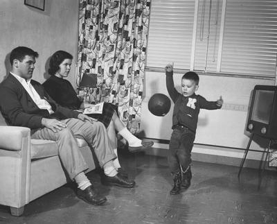 Duke Curnette and Family in the new Cooperstown Apartments, completely furnished and window blinds. Received on March 22, 1957 from Public Relations