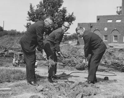 Lyman Ginger (left), Vice President A. D. Albright (center), and Governor Bert Combs (right) are all shoveling dirt, on August 27, 1963, at the ground breaking of Dickey Hall