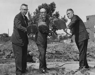 Lyman Ginger (left), Vice President A. D. Albright (center), and Governor Bert Combs (right) are all shoveling dirt, on August 27, 1963, at the ground breaking of Dickey Hall. Photographer: Lexington Herald-Leader staff