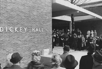 Unidentified men and women are standing outside at the dedication on March 11, 1965, of Dickey Hall