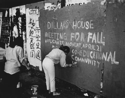 An unidentified student is painting an advertisement for the Dillard House. This photo is first on page 200 of the 1969