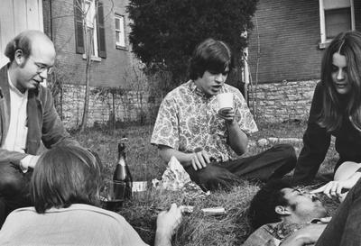 Five unidentified people are outside on the lawn of the Dillard House. This photo is first on page 208 of the 1969
