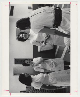 Three female nurses with a patient