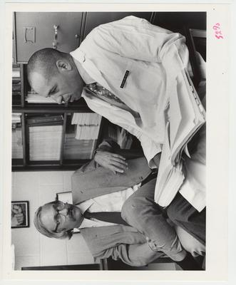 M. C. Maultsby, Jr., M. D. (right), talks with an unidentified man