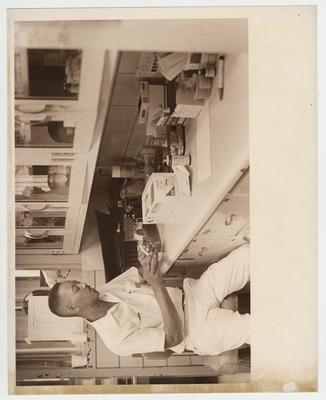An African - American man works in a laboratory