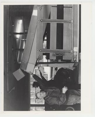 Men unload a box from a truck