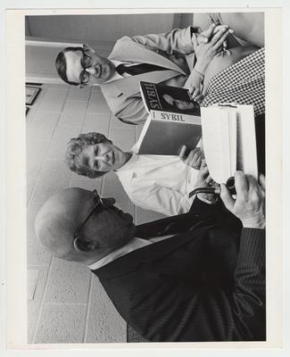 Dr. Cornelia Wibur, Professor of Psychiatry in the College of Medicine, with two unidentified men;
