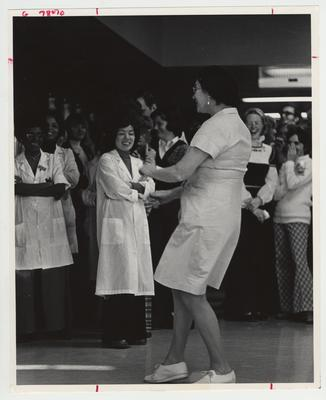 Ruth Goodpastor, a food service worker, dances