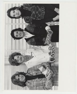 Four unidentified women holding gifts