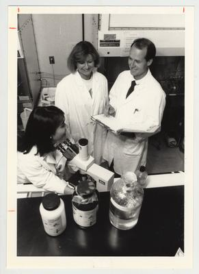 Three students in a laboratory in the Graduate Center for Nutritional Sciences