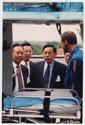An unidentified man talks to visitors from Shandong Ji'Den, China, about medical helicopter procedures