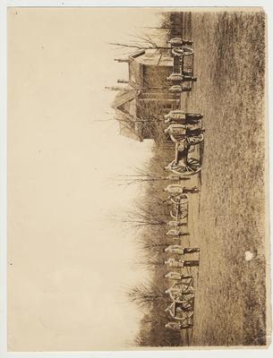 Men in uniform firing cannons
