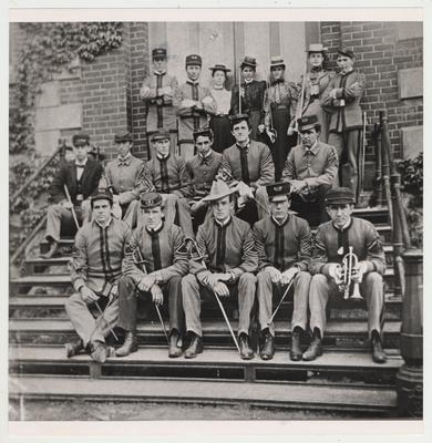 Commissioned officers on the steps of a building at Kentucky State College.  Sponsors of the day wore sailor hats and carried sabers