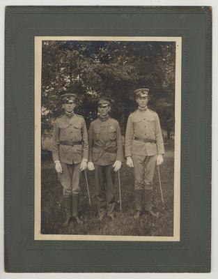 Three men in uniform.  Professor T. R. Bryant, Capt. Phil Corbusier, and Professor H. H. Downing